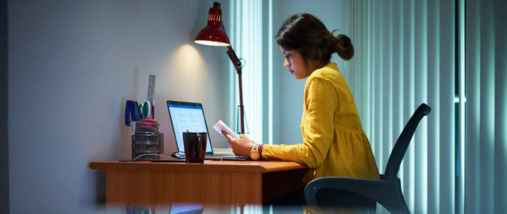 woman studying by laptop