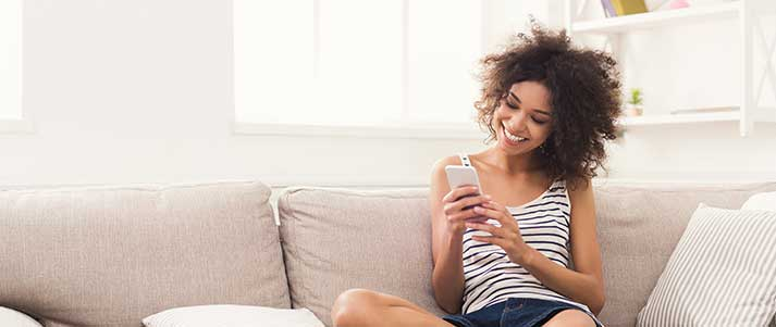 woman on phone on sofa