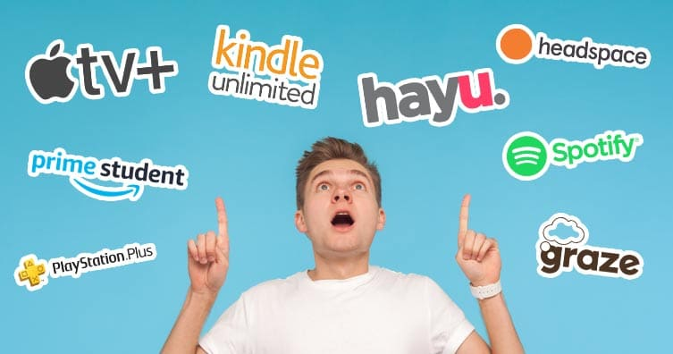 man surrounded by company logos