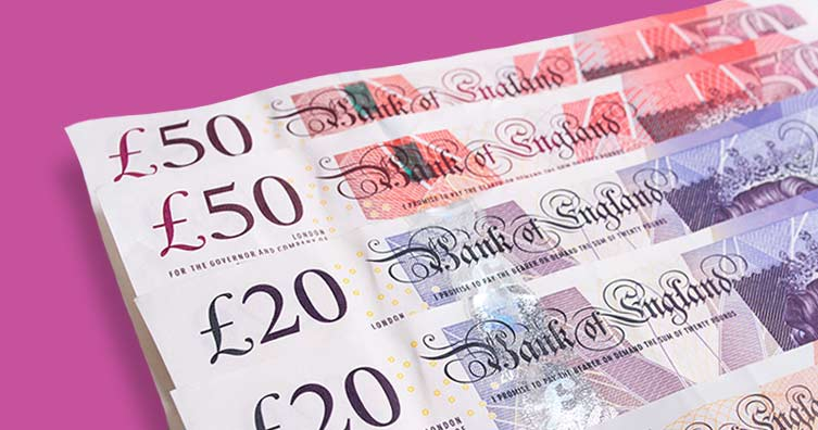 uk money notes against pink background